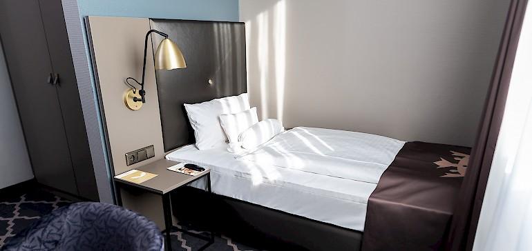 Wir bieten klassische Einzelzimmer in zwei verschiedenen Kategorien