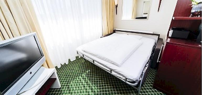 Schlafcouch im Familienzimmer im Kaiserhof Münster für bis zu zwei Kinder